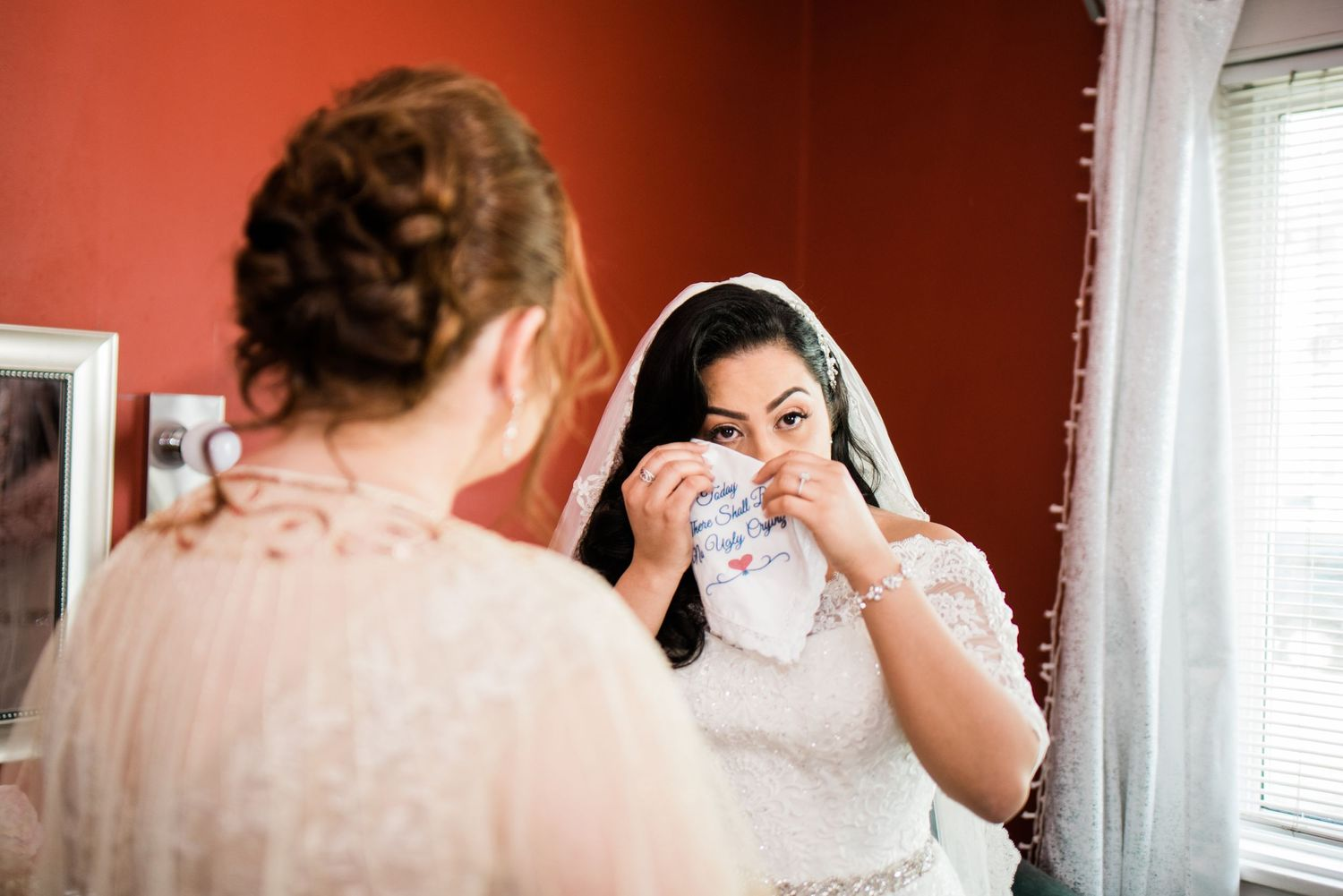bride using hanker-chief to wipe tears away