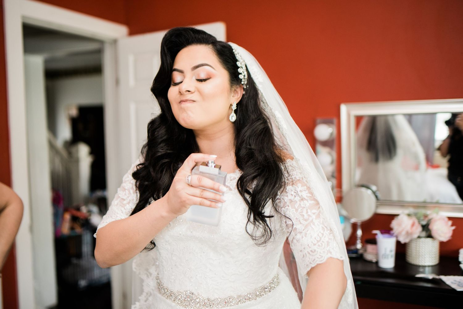 bride spraying on perfume
