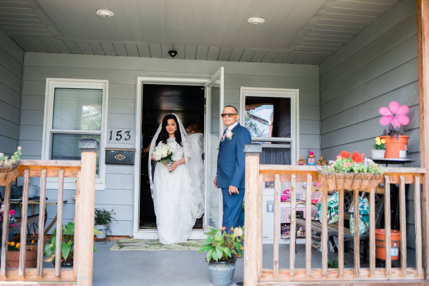 bride walking out of childhood home