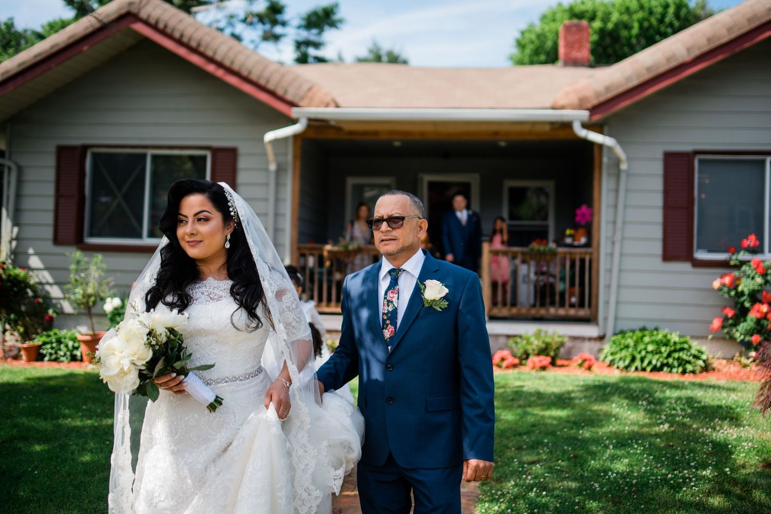 bride walking with dad toward car