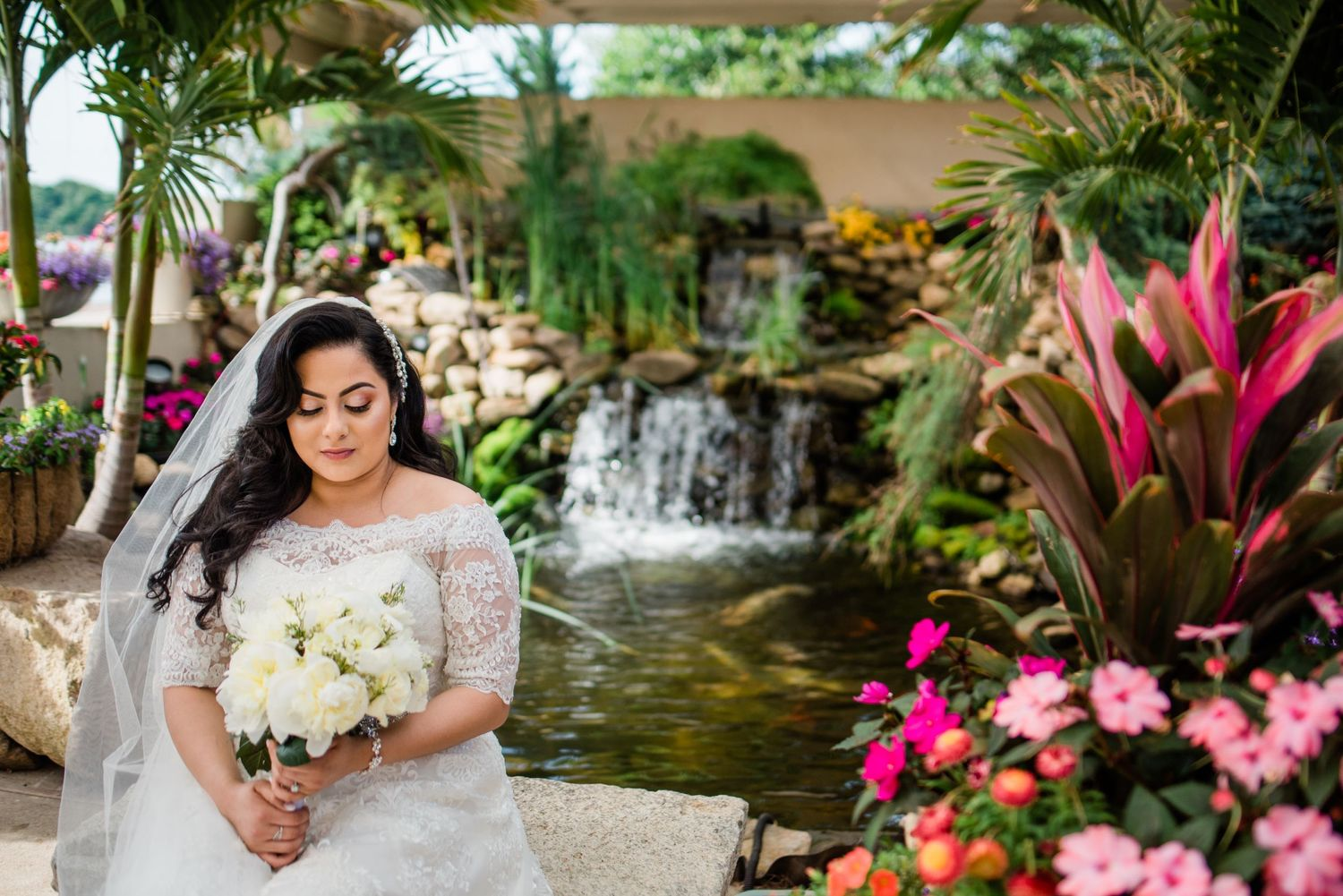 bride portrait sitting by flowers