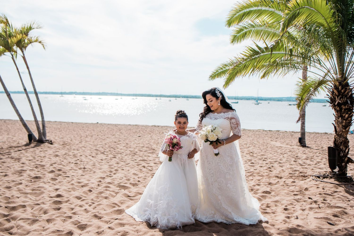 bride and junior bride on beach