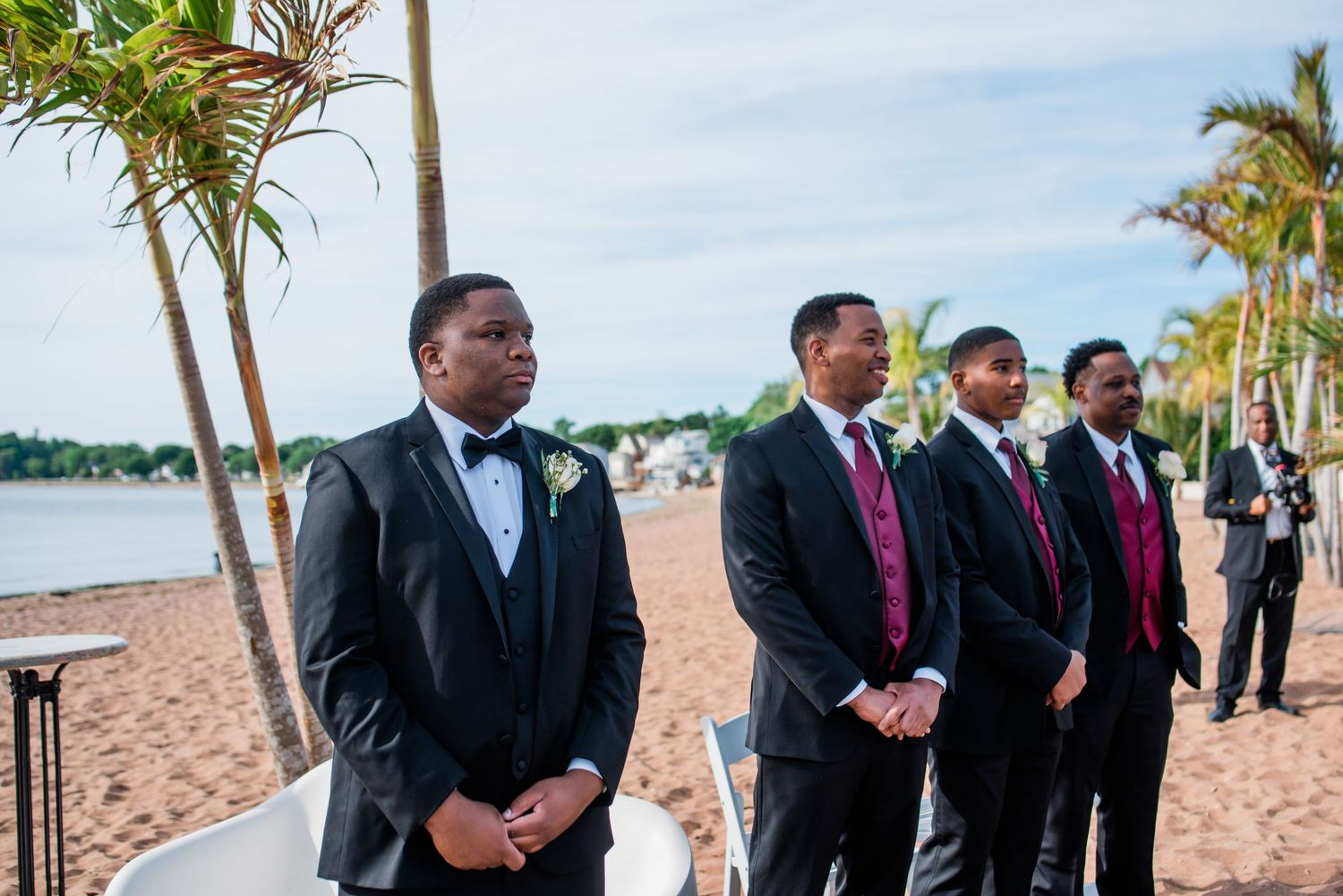 groom and groomsmen waiting for bride