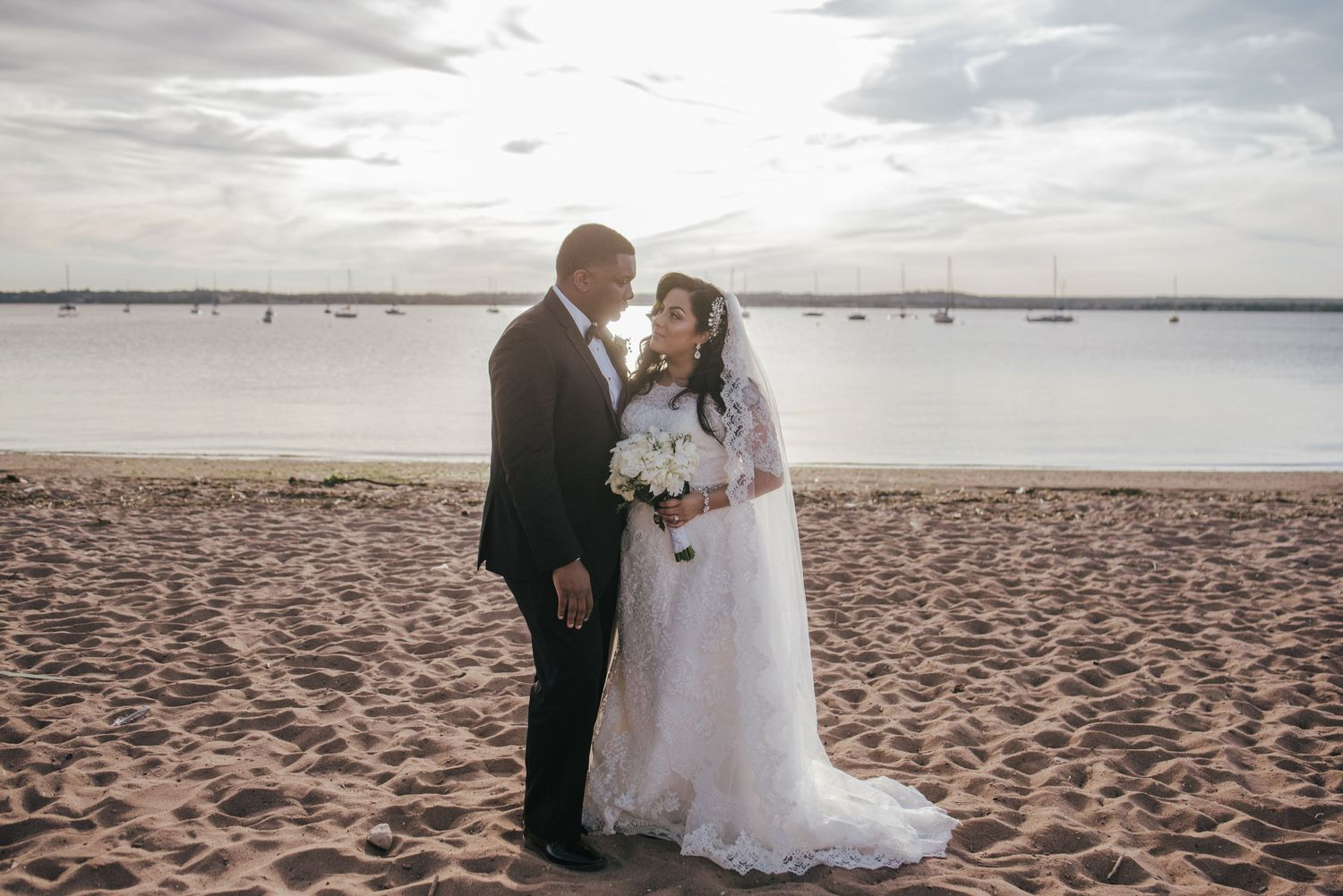 bride and groom portrait at the beach