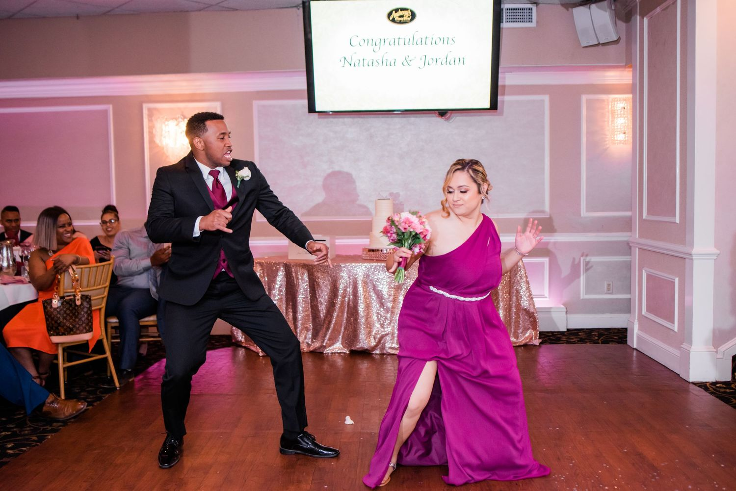 groomsmen and bridesmaid dancing in reception
