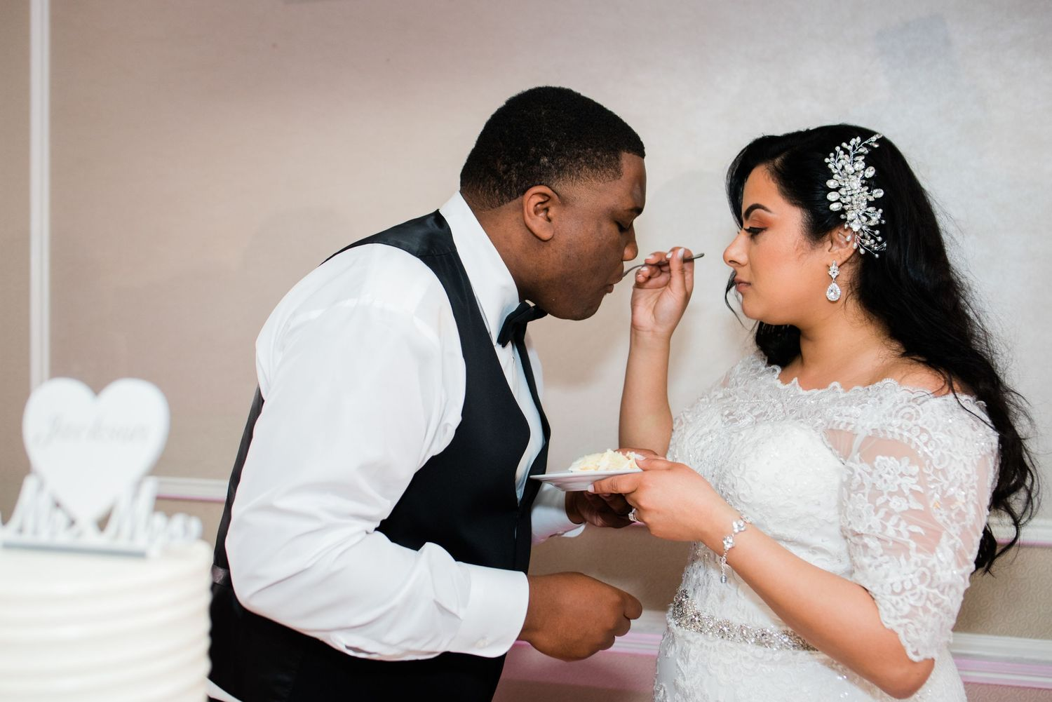 bride feeding wedding cake to groom