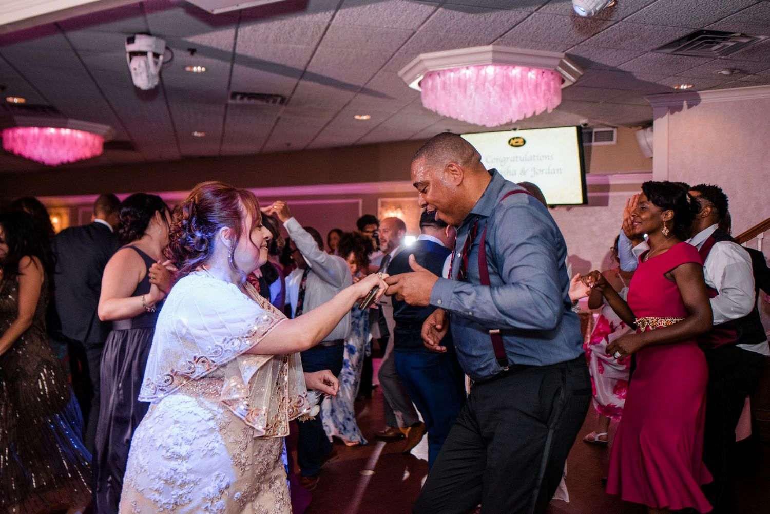 bride and wedding guest dancing at reception