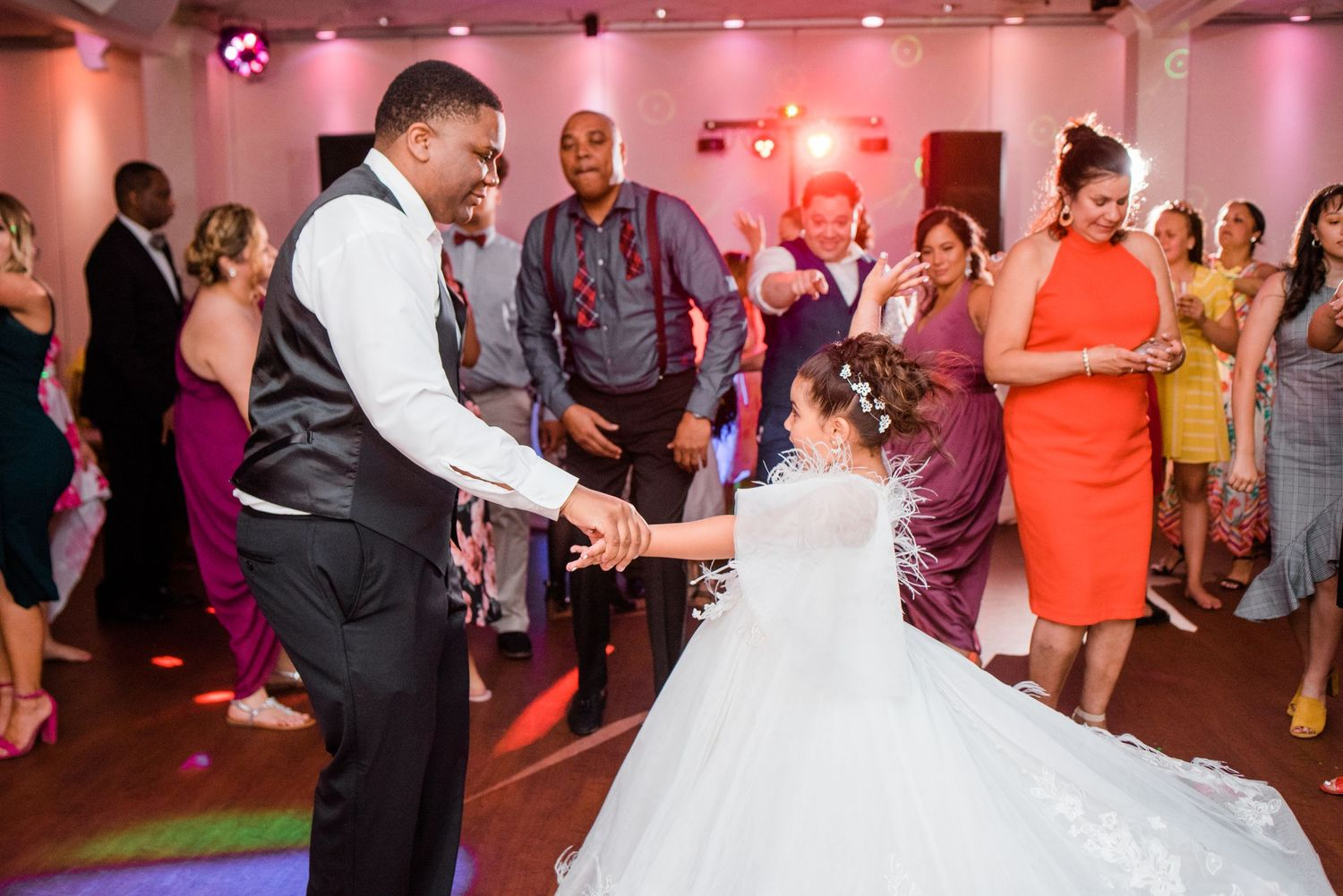 groom dancing with junior bride