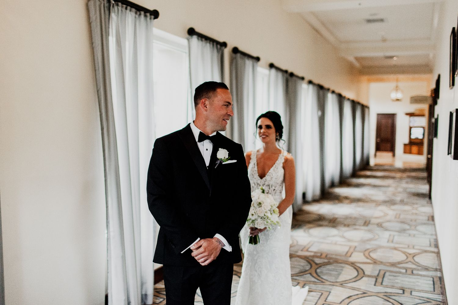 groom turning around to see bride for first time in wedding dress