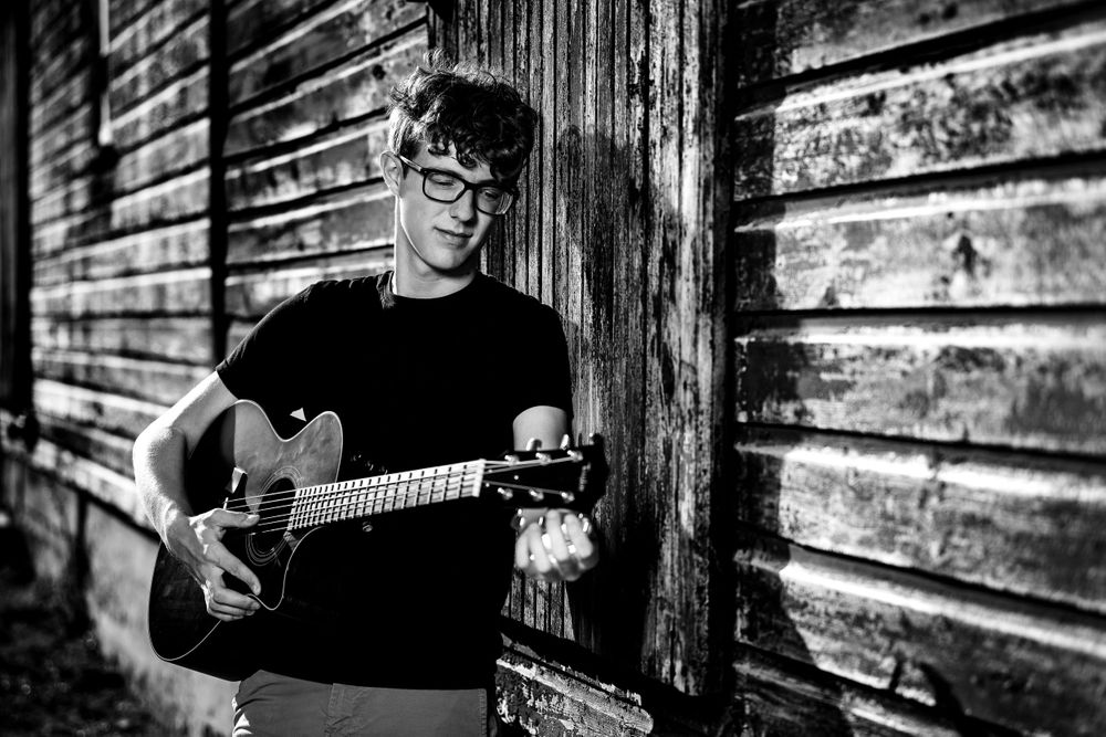 Guitar player, old barn, senior photos, black and white