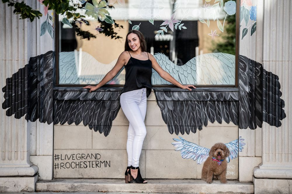 Senior photos with angel wing, red toy poodle, black strappy shoes