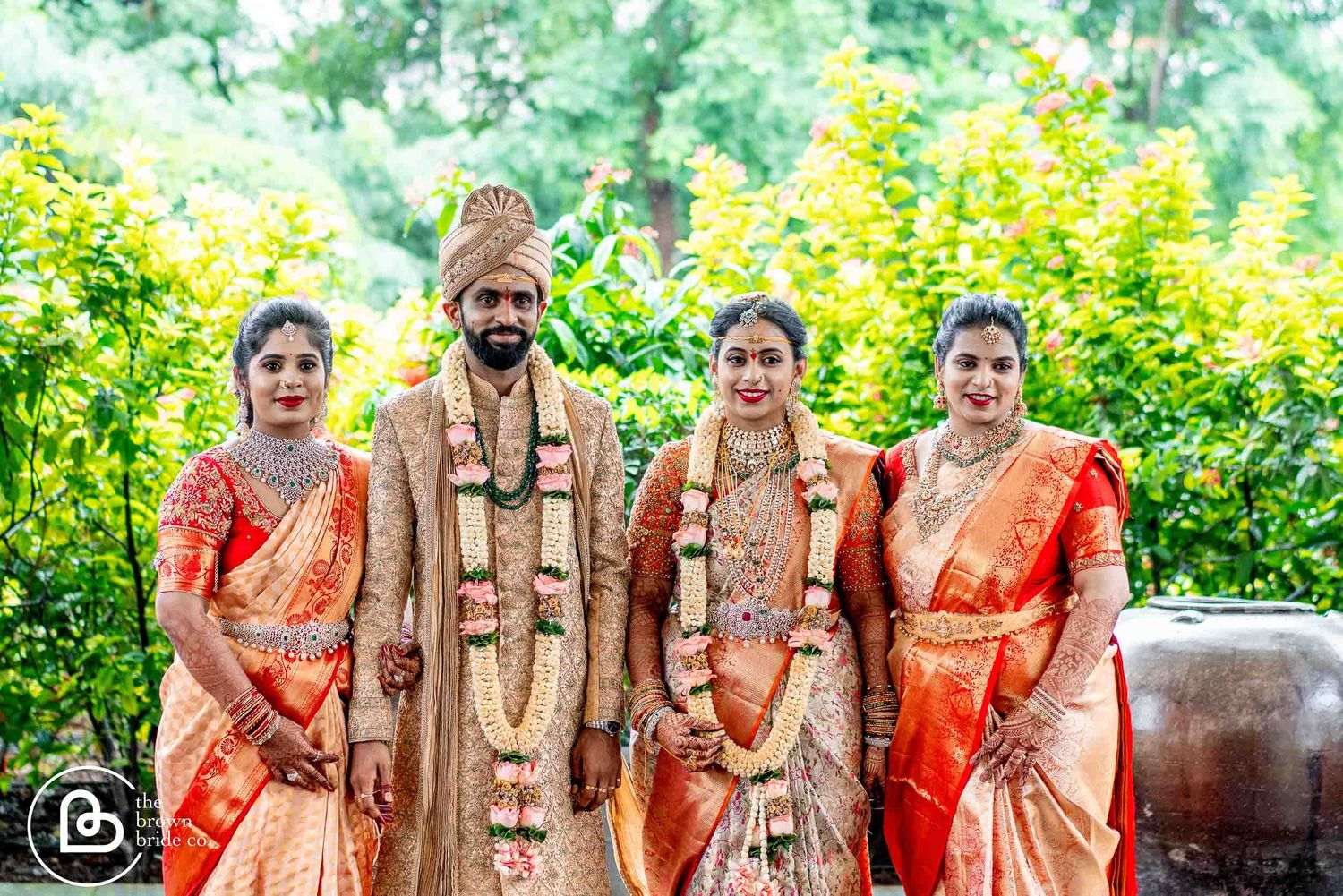 wedding venue hyderabad | bride and  groom together with family, brown bride wedding photo shoot