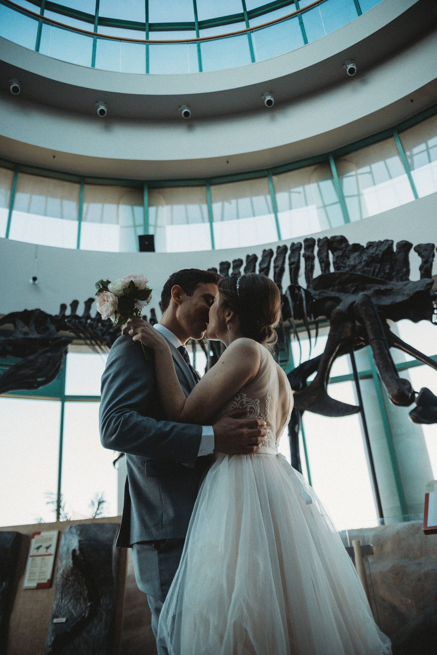 top of dome visible while bride and groom kiss passionately