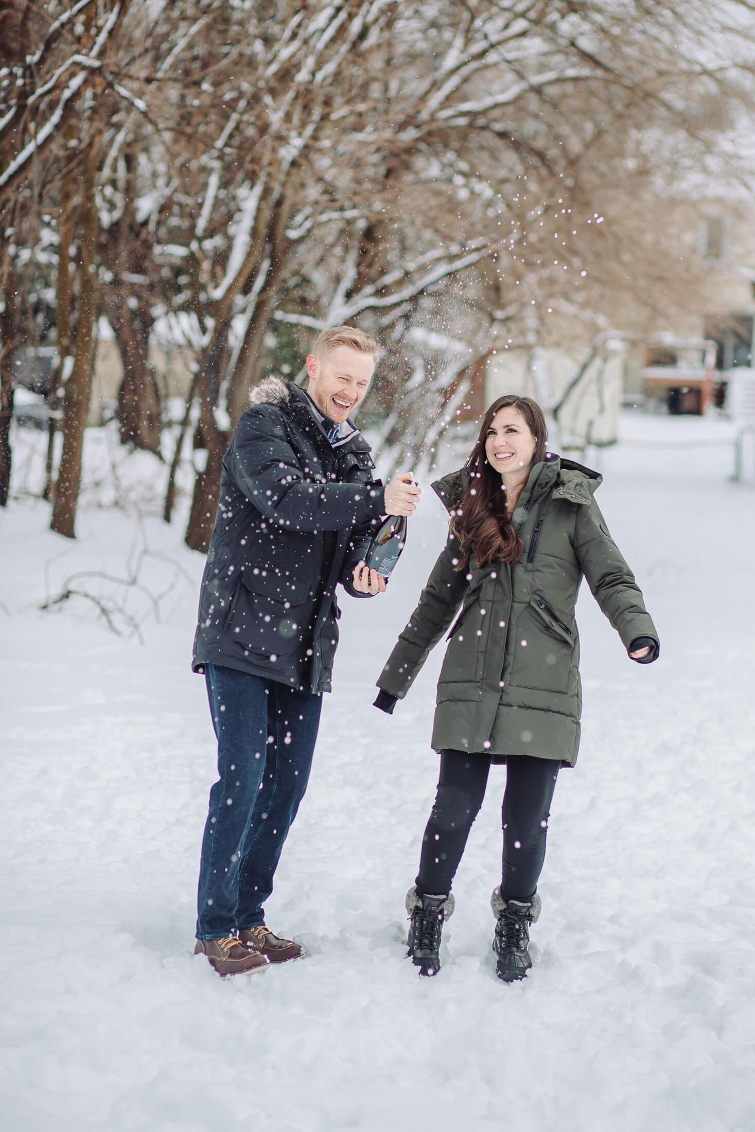 Champagne pop winter engagement photography in Collingswood, NJ.