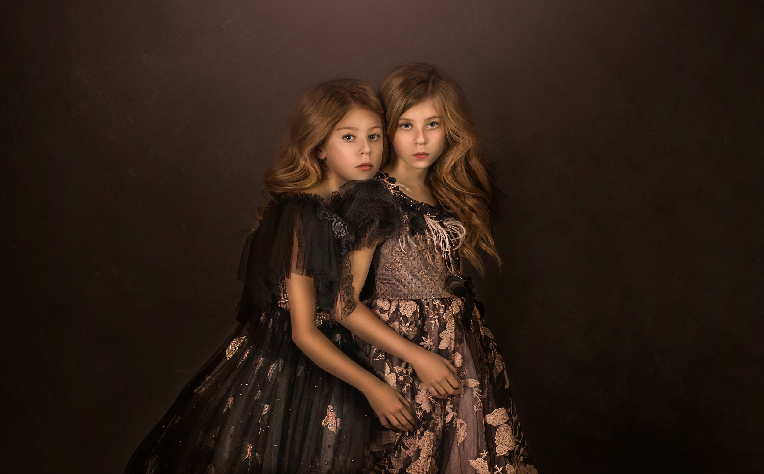 Twins in studio wearing couture Anna Triant gowns captured by Ammara Crittenden