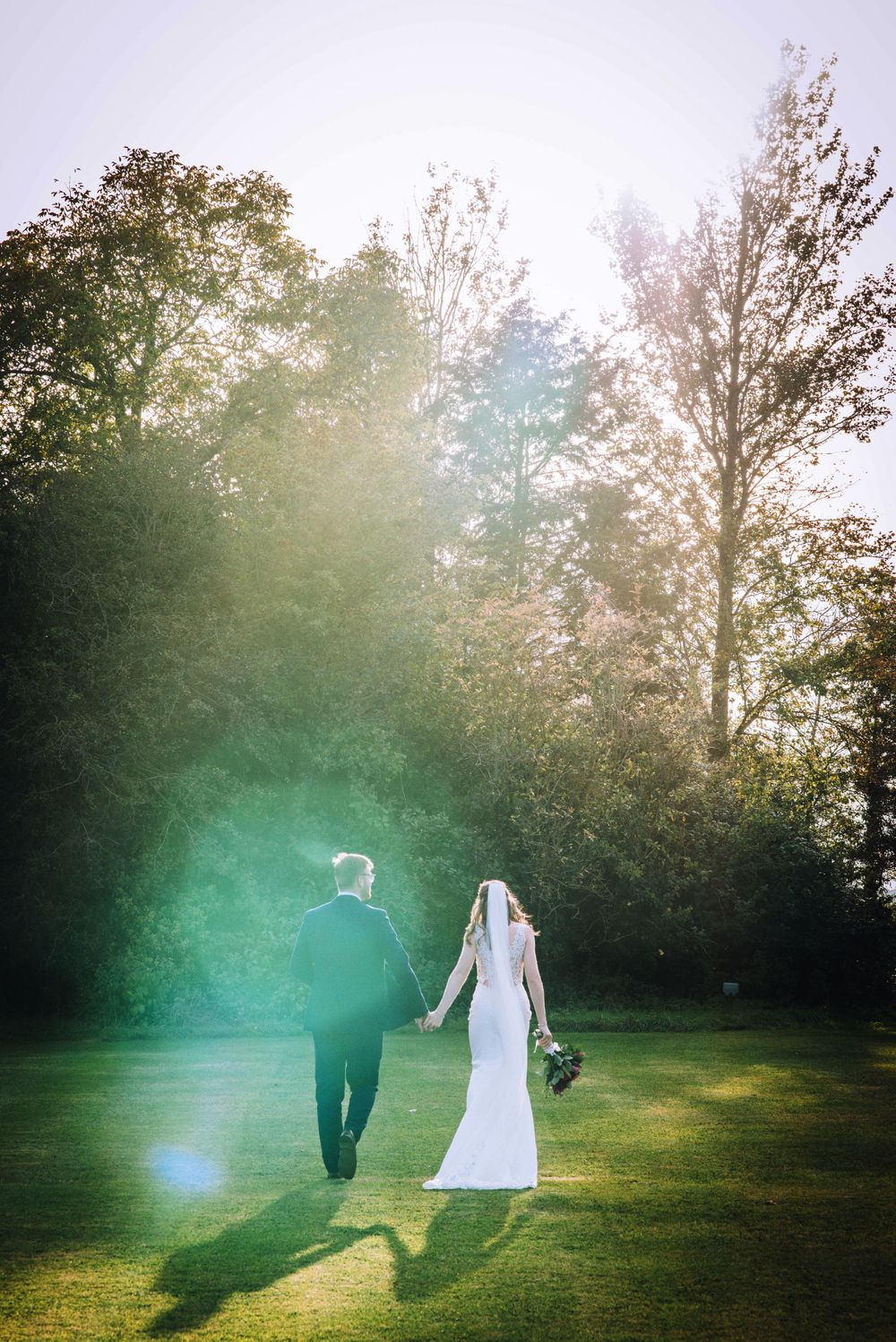 Cricklade House Hotel wedding by Zara Davis Photography, Gloucestershire walking away under the sun