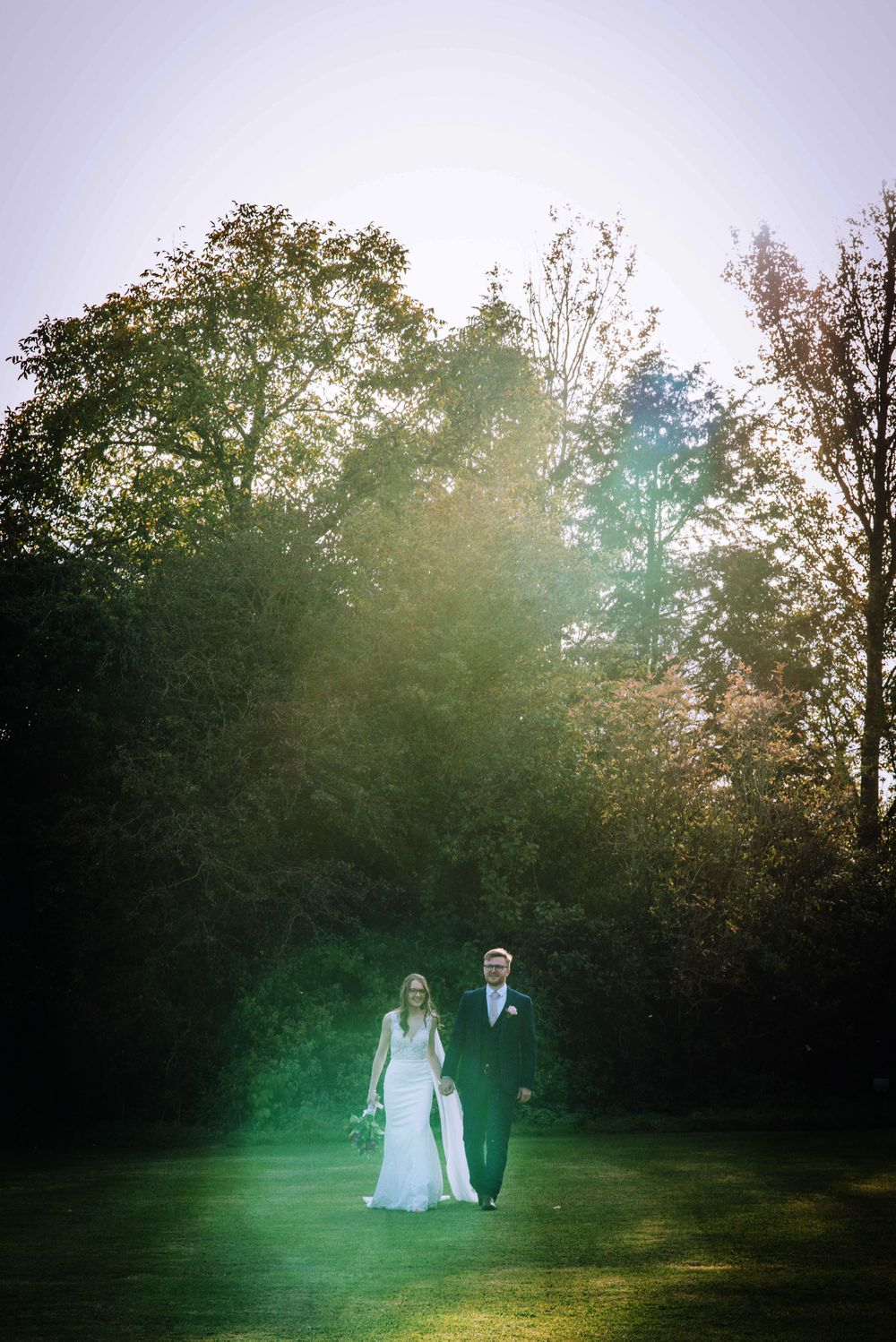 Cricklade House Hotel wedding by Zara Davis Photography, Gloucestershire walking towards in the sun