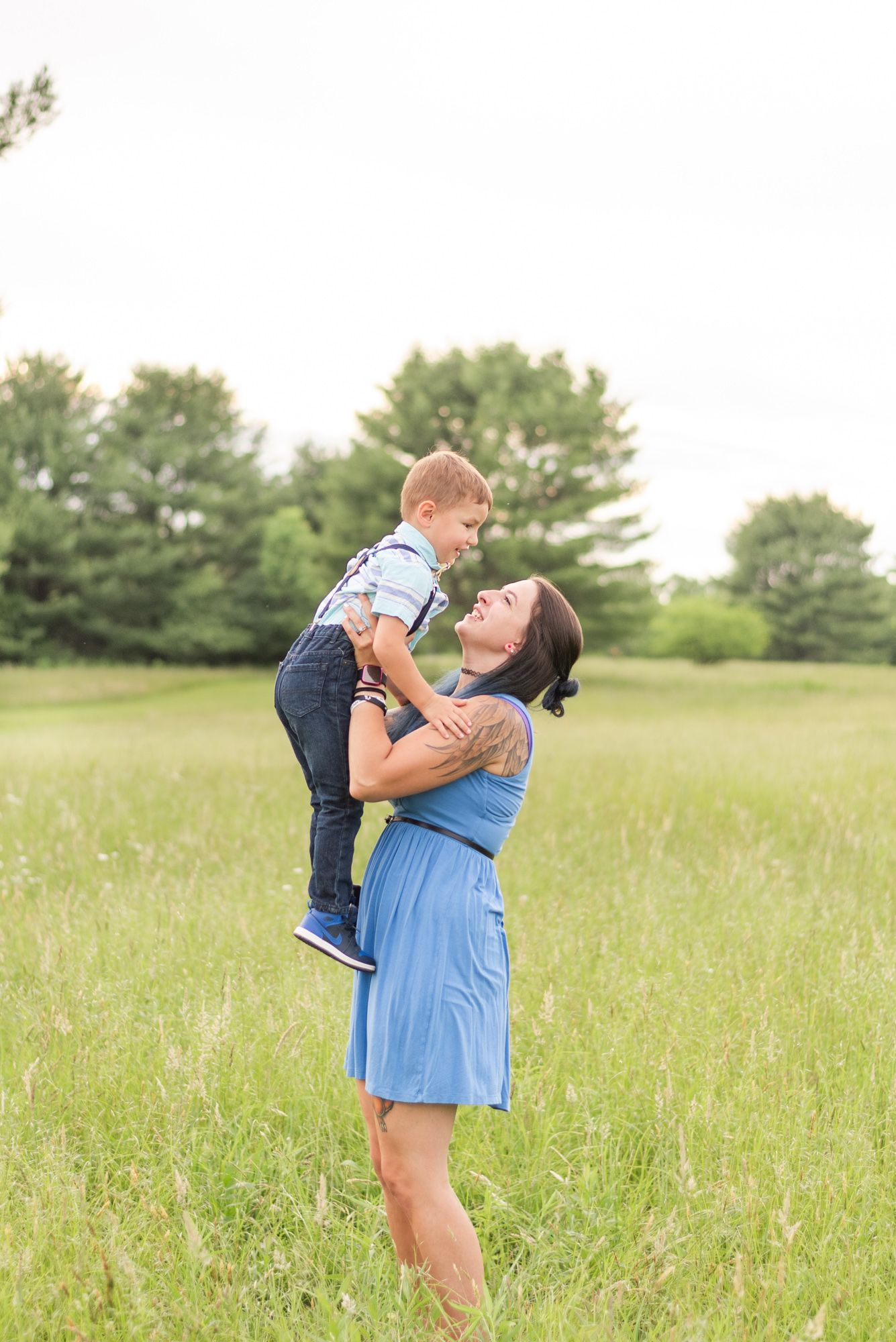 Mom holding son in field in Clarion Pennsylvania
