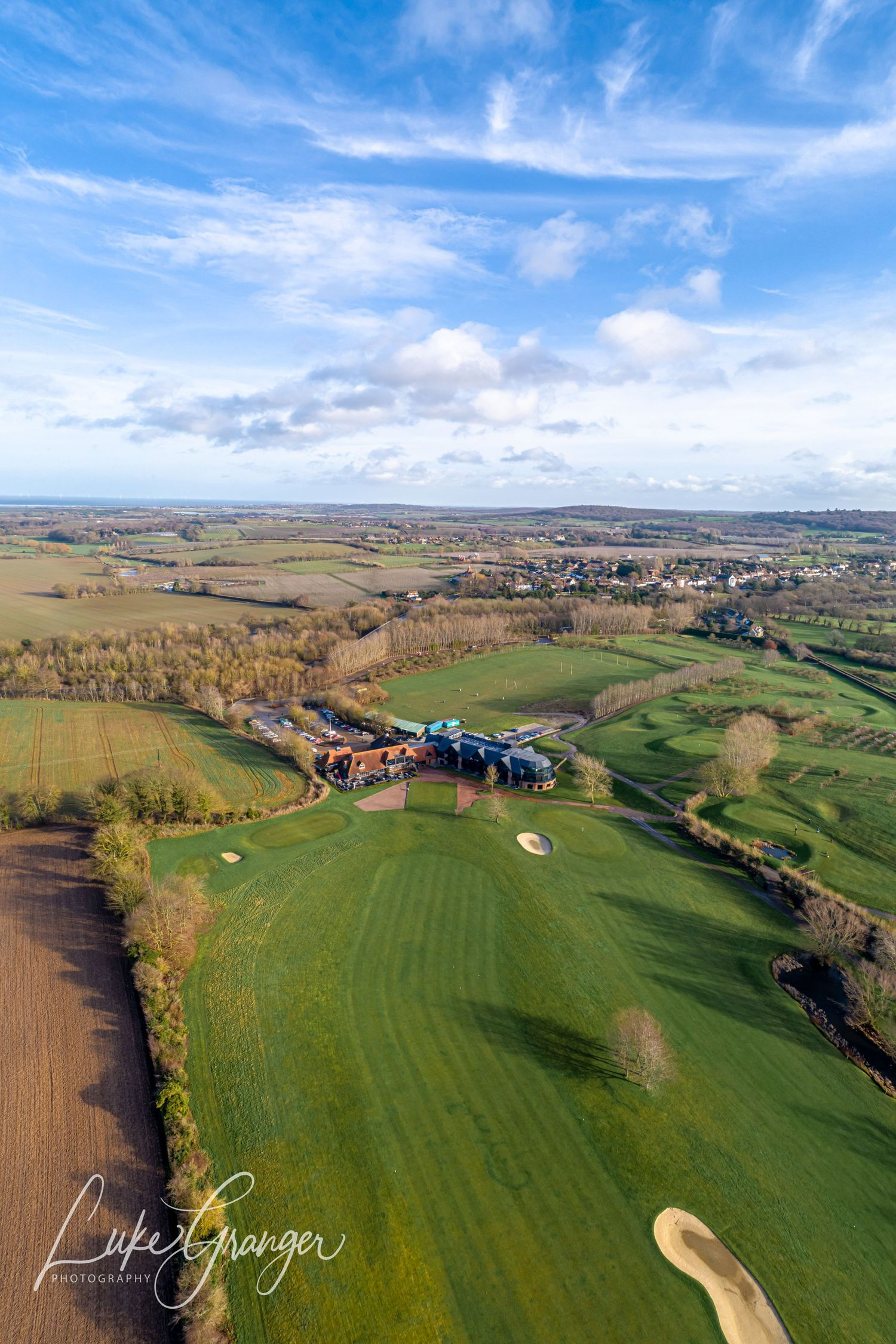aerial drone photo of the cave hotel showing the golf course and venue with beautiful blue sky