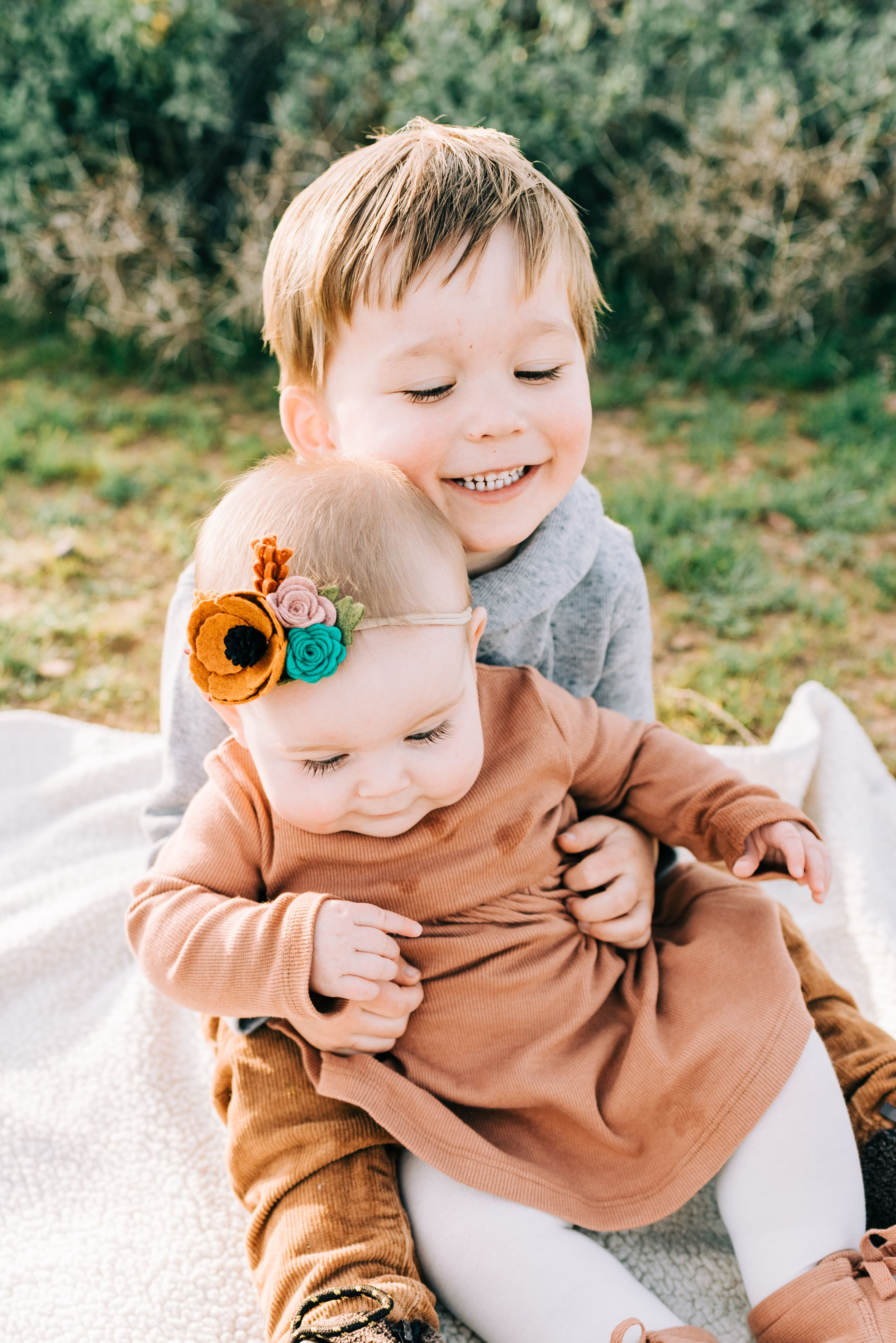 Sibling hugging during family photos
