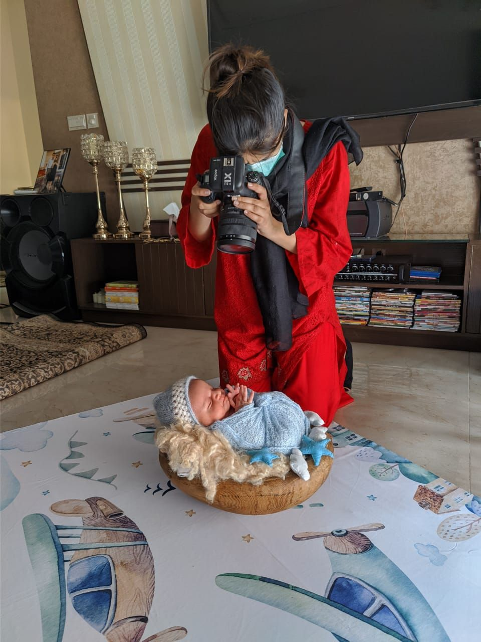 Newborn Photographer Annem Zaidi taking photos of newborn baby