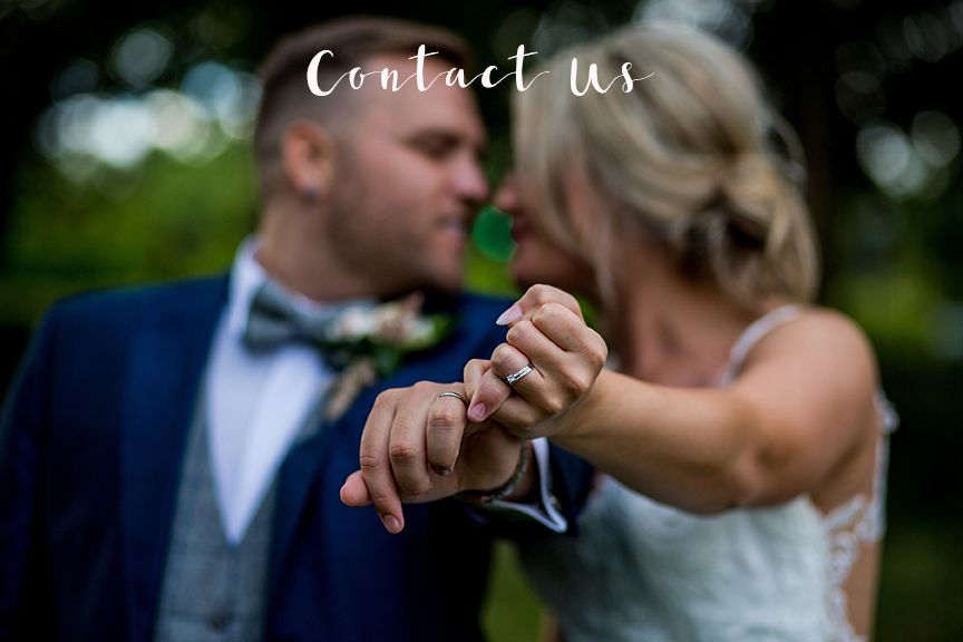 Bride & Groom with hands entwined showing wedding rings