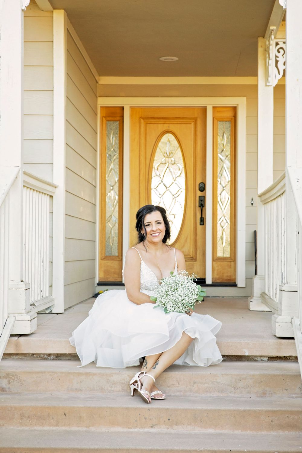 Bride on the steps at The Grace Maralyn Estate, Atascadero, California