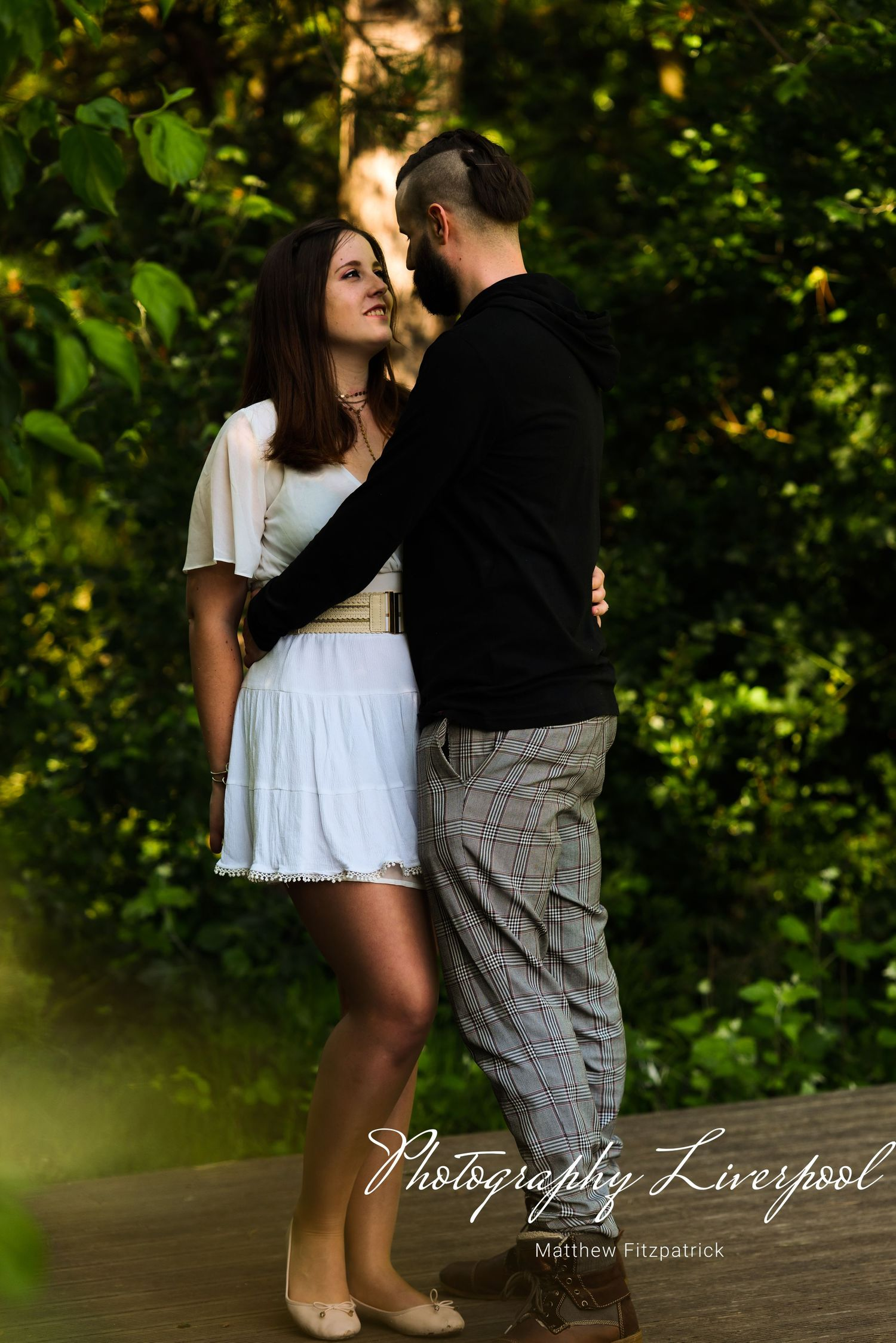 Naturally posed engagement photography at Liverpool Festival Gardens by Photography Liverpool