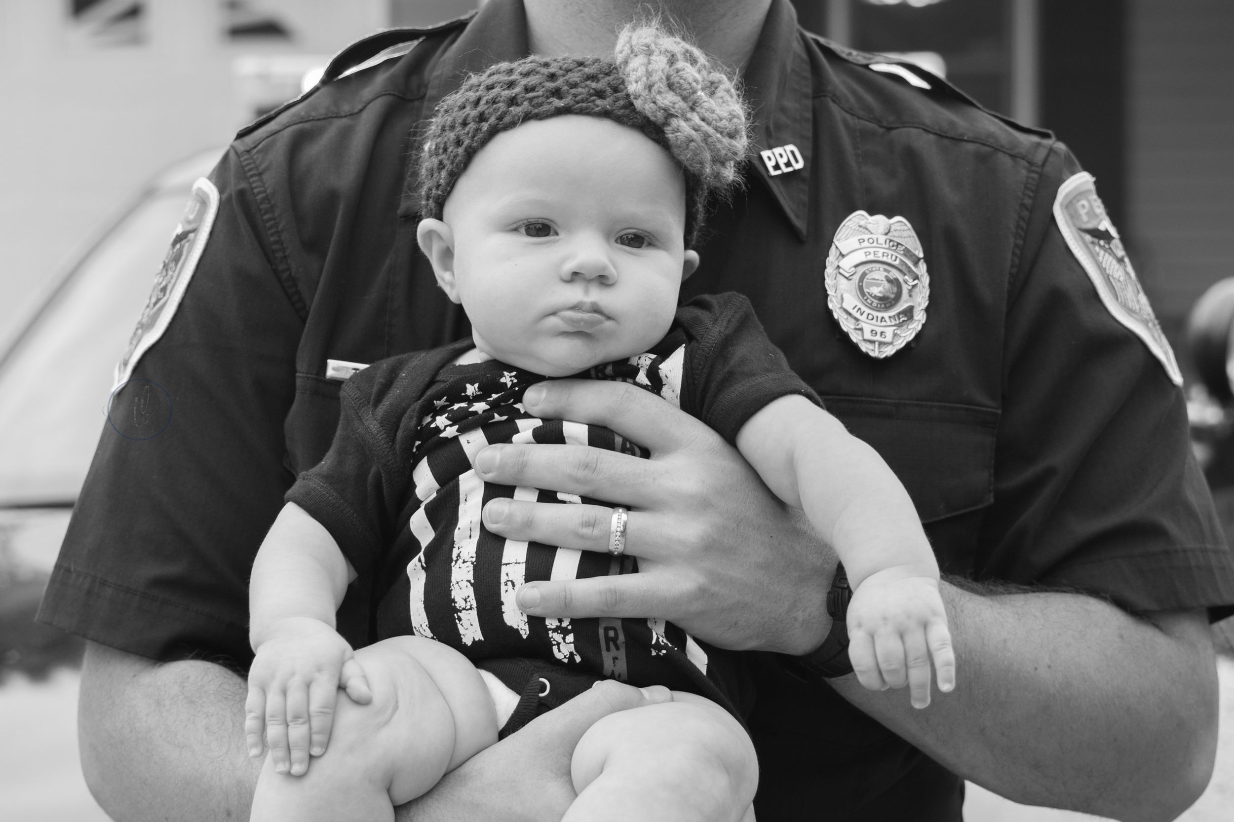 Dad and baby girl in uniform