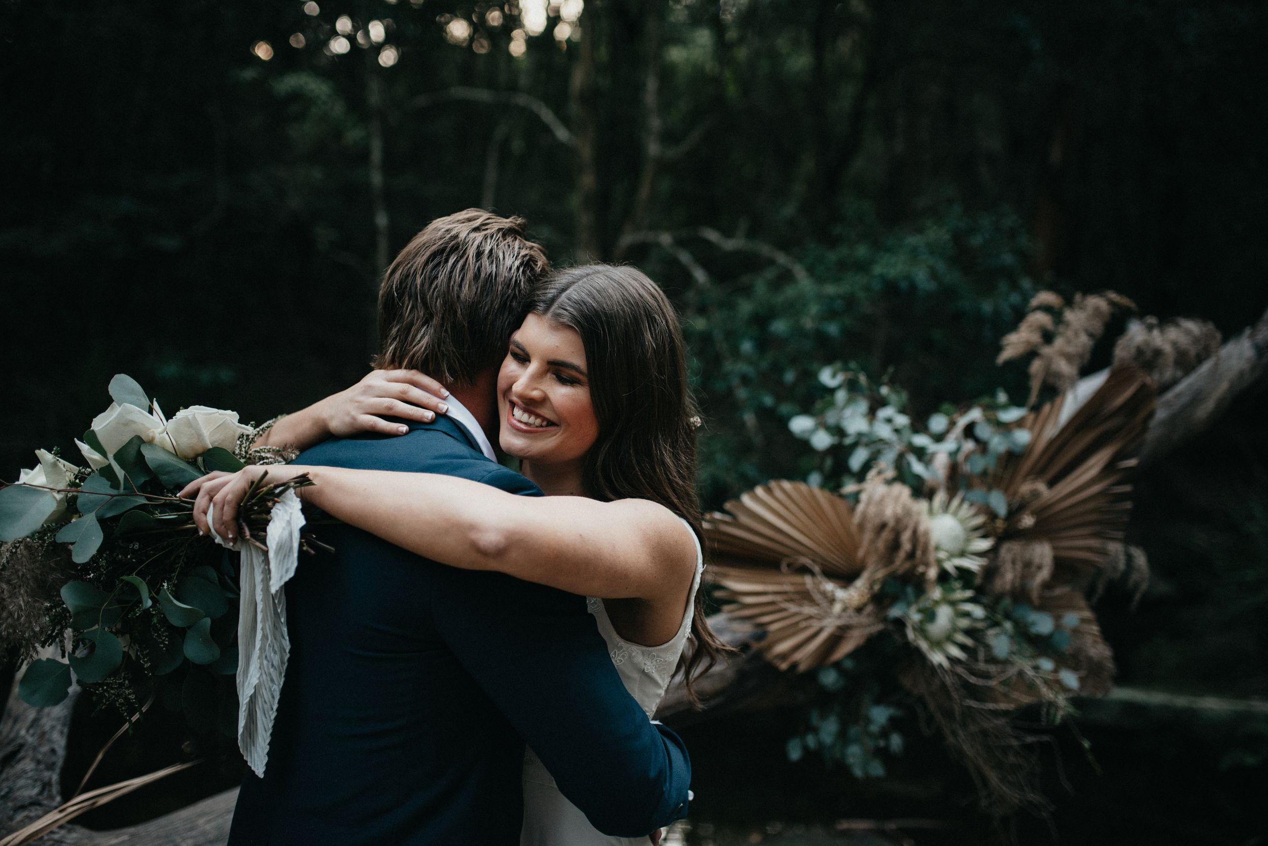 moody wedding photography of couple hugging in glenrock forest newcastle