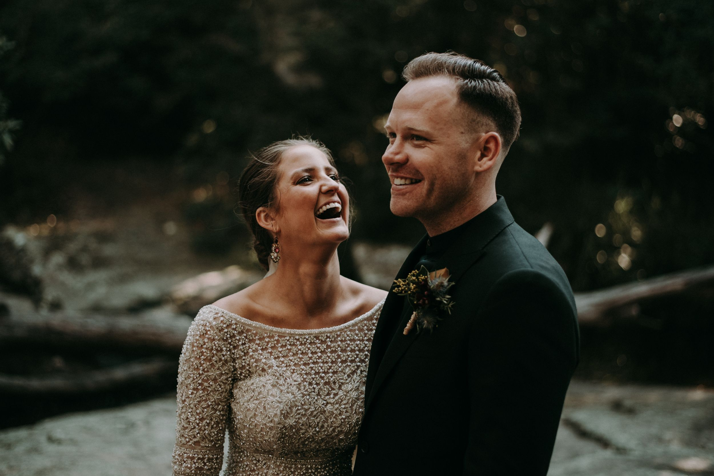 moody wedding photography of bride laughing in glenrock forest newcastle
