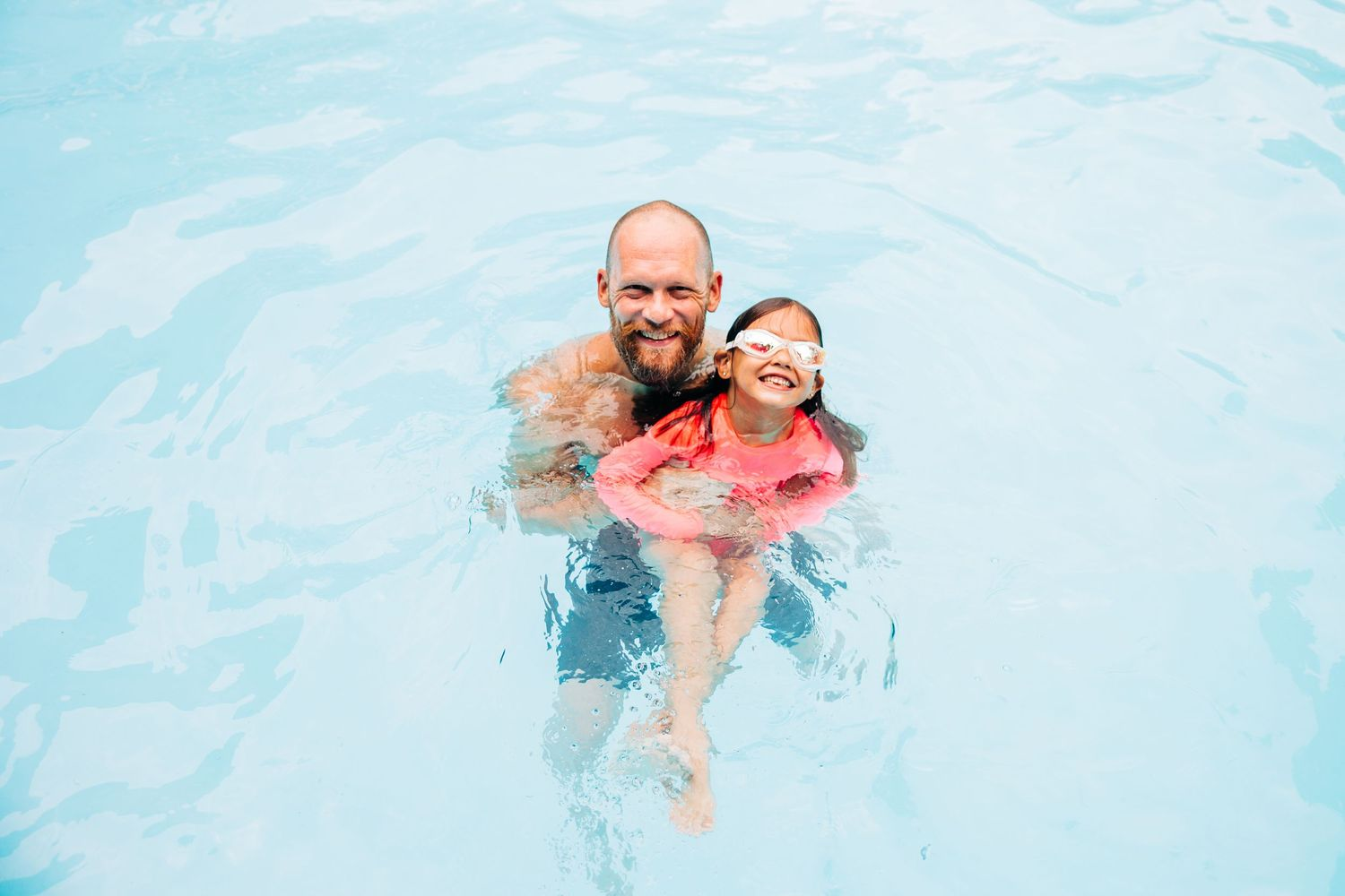 Dad and daughter in their Dilworth pool
