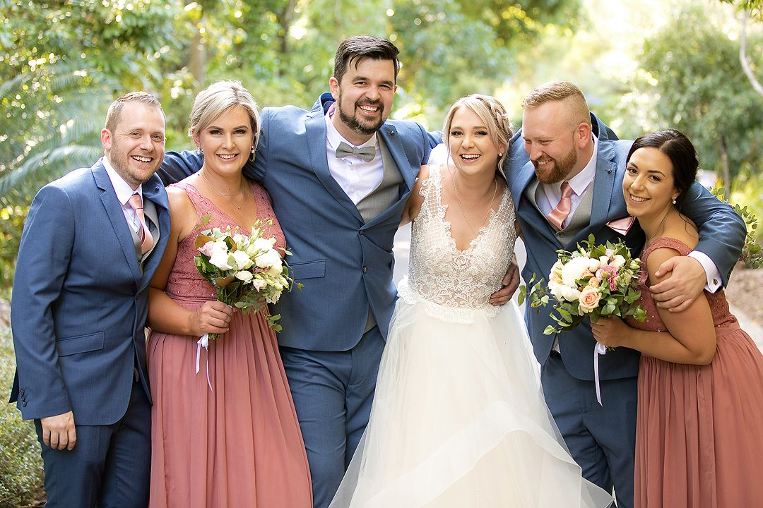Wedding bride and groom with their bridal party at the Rock Lawns of The Australian National Botanic Gardens Canberra