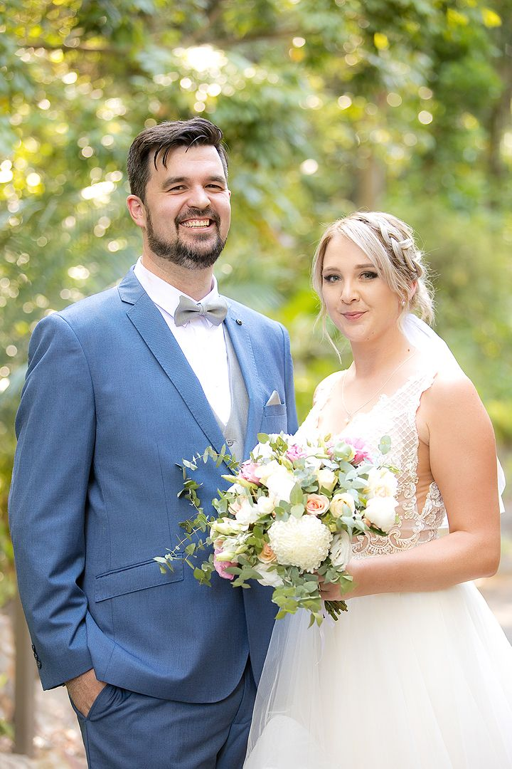 Bride and groom on their wedding day at the Rock Lawns of The Australian National Botanic Gardens Canberra