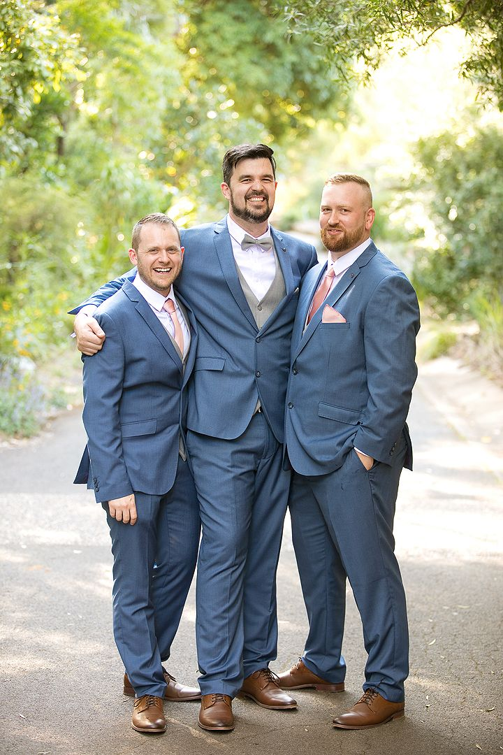 Groom with his groomsmen on his wedding day at the Rock Lawns of The Australian National Botanic Gardens Canberra