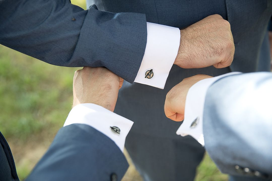 Groom and groomsmen cuff-links together at the Rock Lawns of The Australian National Botanic Gardens Canberra