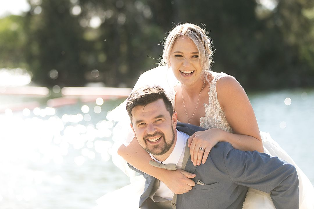 Bride and groom on their wedding day at Lake Burley Griffin Canberra