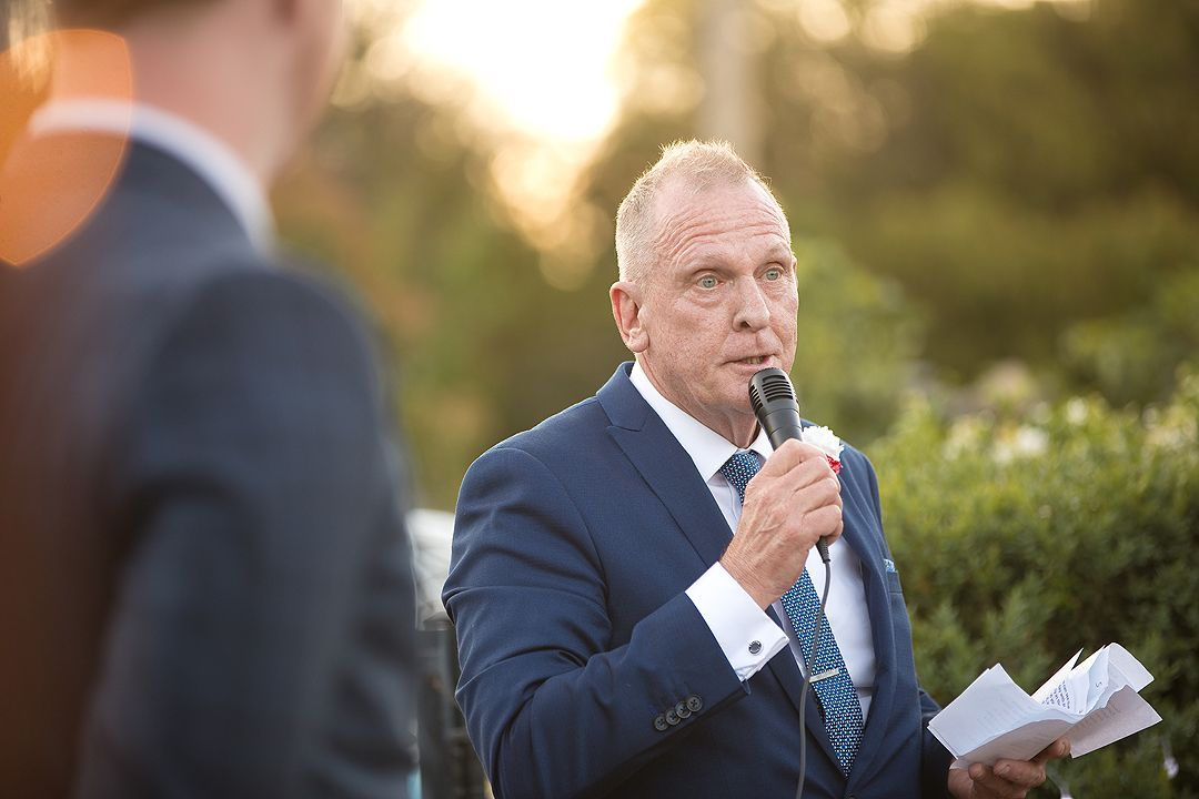 Father of the bride giving speech at his daughter's wedding reception in Canberra