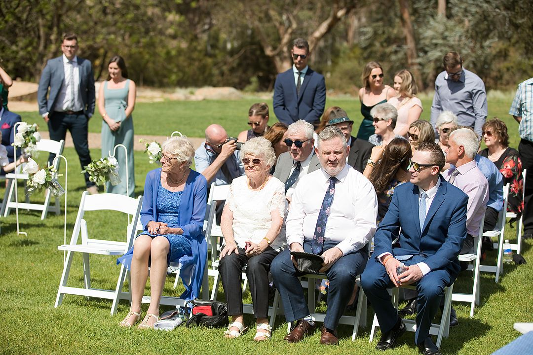 Wedding ceremony guests seated at the Rock Lawns of The Australian National Botanic Gardens Canberra