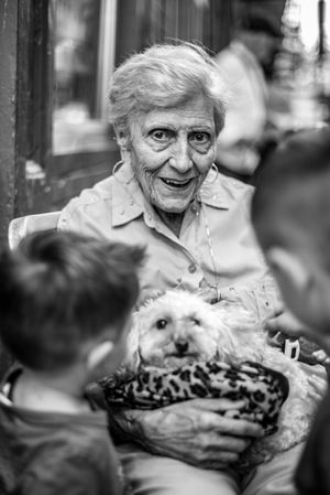 Elderly woman holding a puppy in Boston's North End