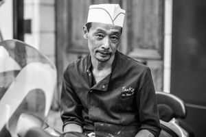 Paris restaurant employee taking a cigarette break