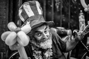 Animated street vendor wearing Uncle Sam hat