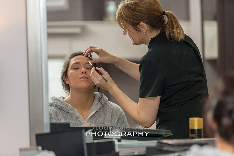 bride having eyebrow make up applied