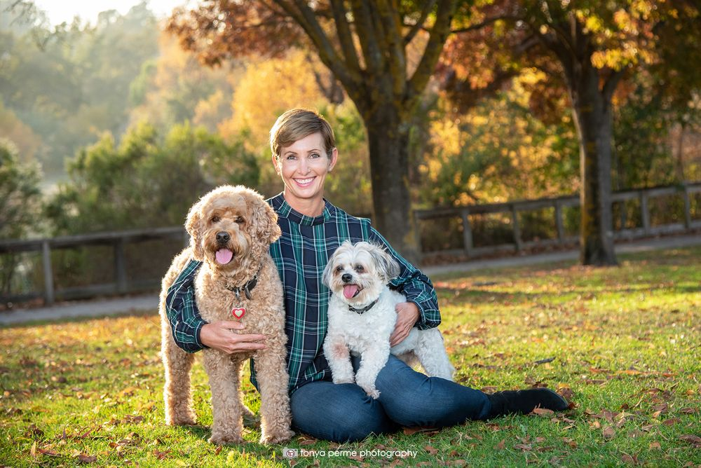 Golden Doodle and Shih Tzu with woman outside