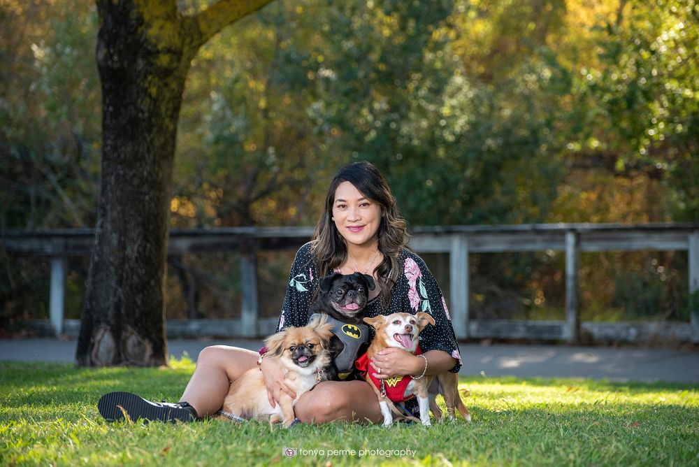 Pekingese, Pug, and terrier mix with woman in Bay Area park