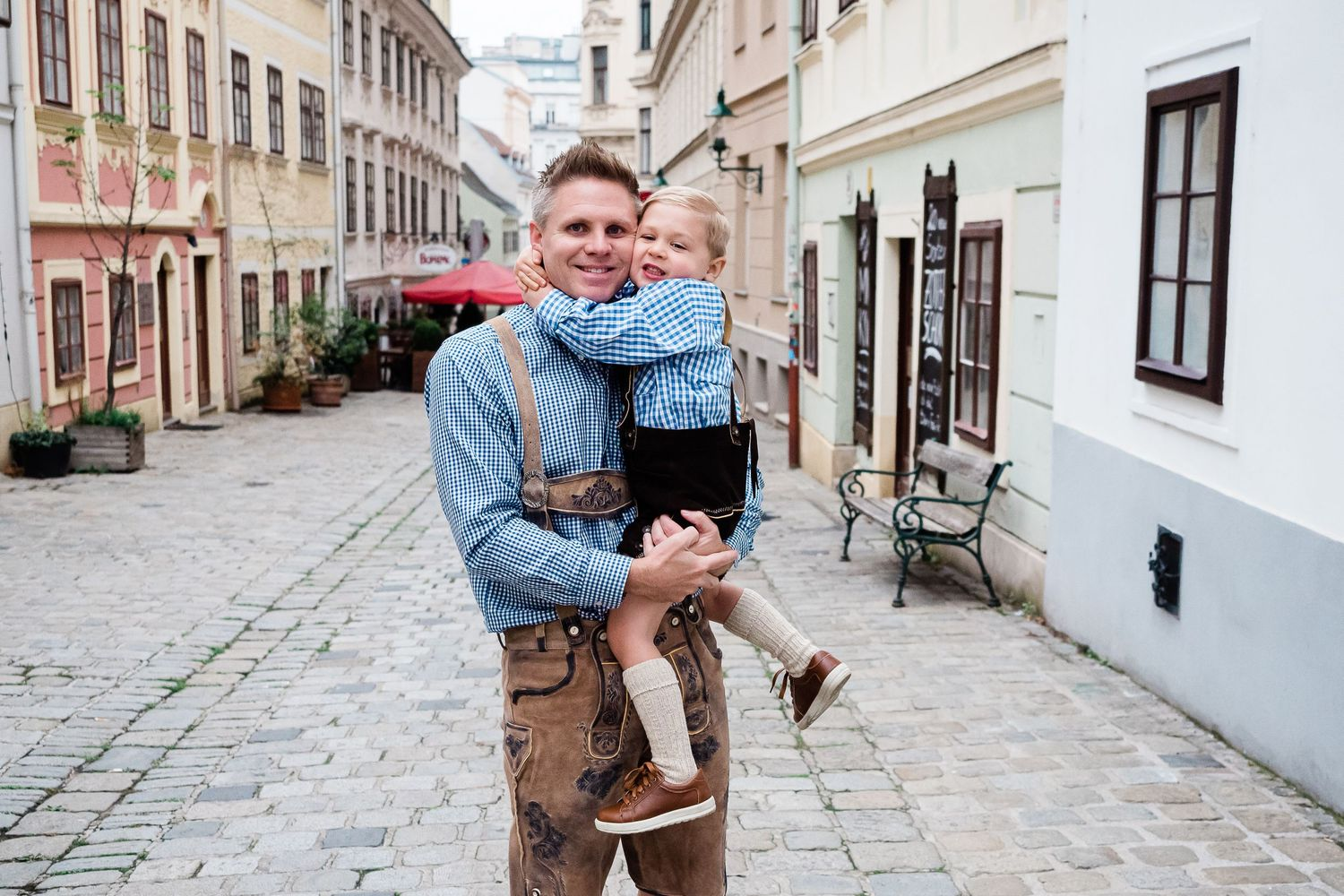 Father and son photograph wearing lederhosen in Vienna Austria