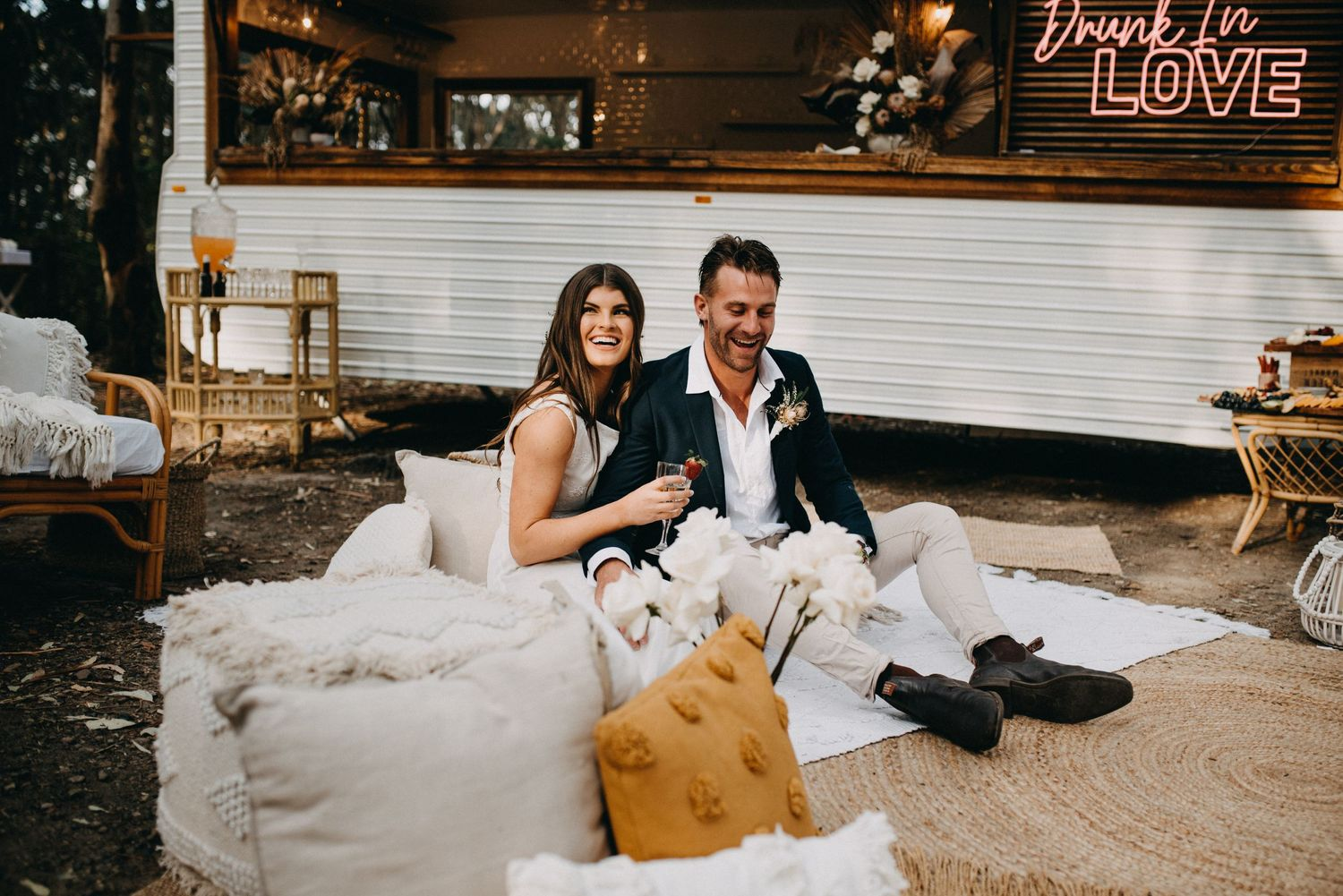 wedding photography of couple sitting with caravan glenrock forest newcastle nsw