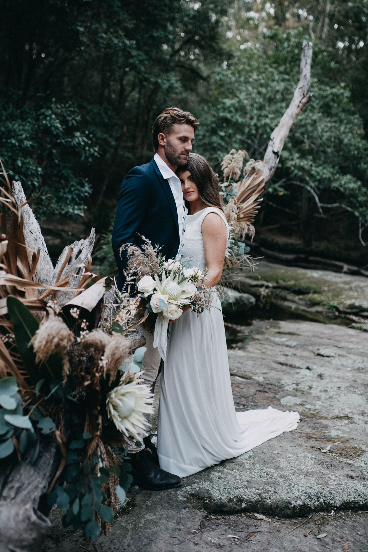 wedding photography of couple with flowers glenrock forest newcastle nsw
