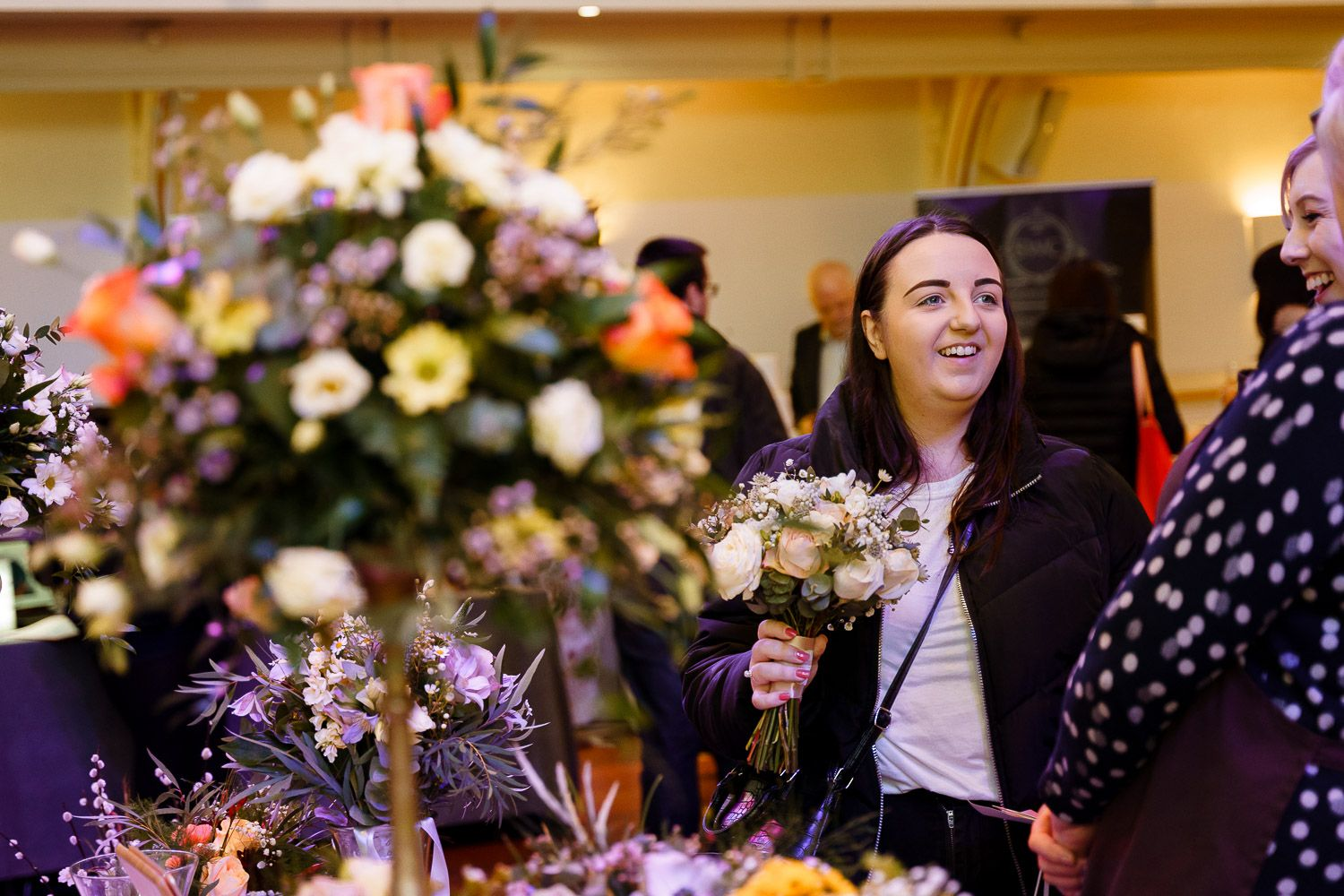 A bride-to-be chats with a florist at a wedding fair in Winchester.