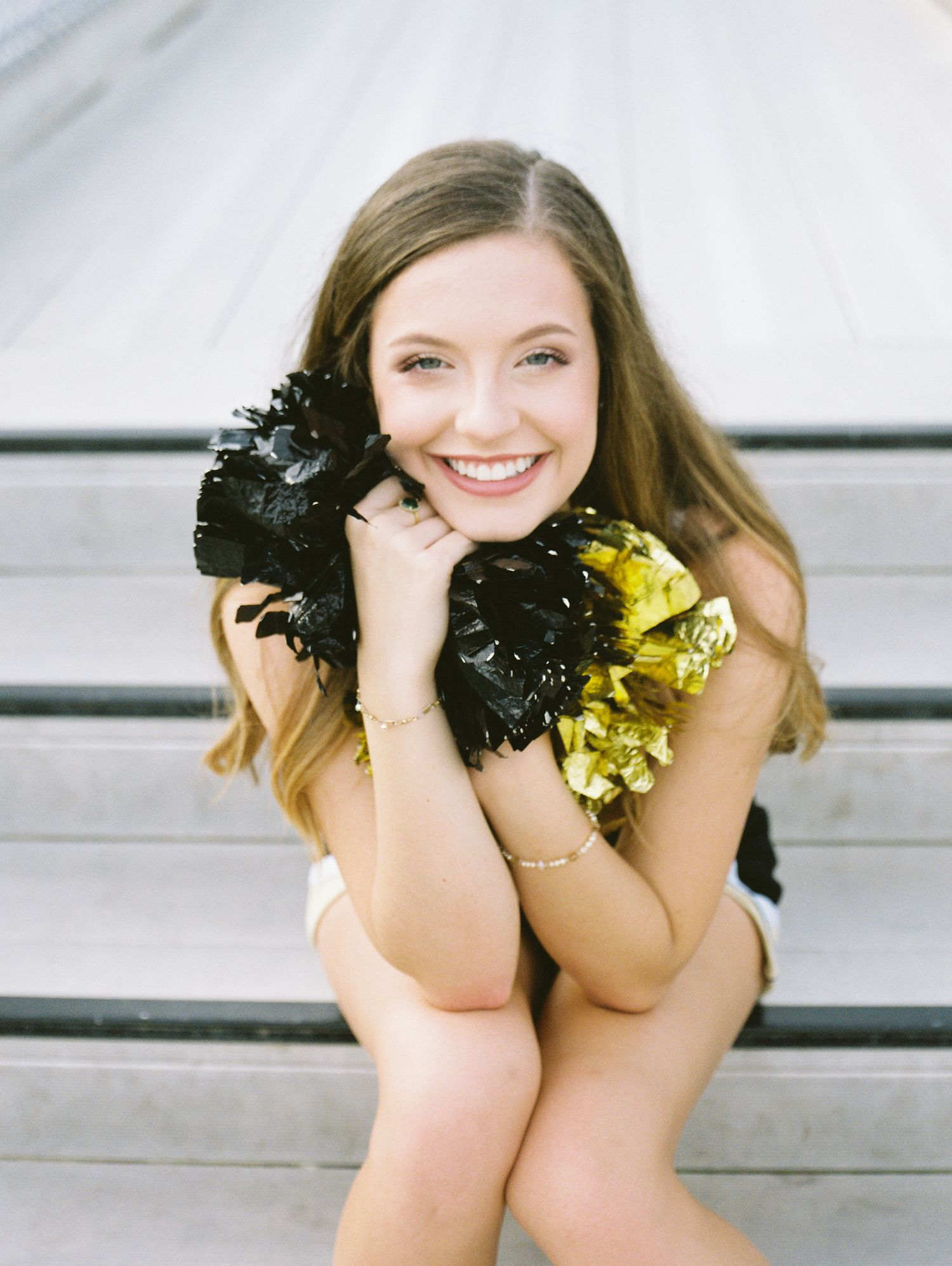 Louisiana senior portrait photography of Oak Forest Academy cheerleader in the football stadium